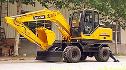 设计定位主打多功能抓装性能 宝鼎BD95W-9轮式挖掘机抓木机体验